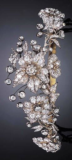 AN ANTIQUE DIAMOND TIARA  Designed as a tapered series of old European-cut diamond flowers, buds and leaves, circa 1850