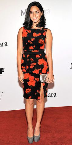 OLIVIA MUNN Floral print. Side slit. Peplum. Olivia's red-and-black Max Mara design is a whole lotta look. And we haven't even gotten to her gray Saint Laurent kicks and that metallic clutch, all worn to the Max Mara and W Magazine cocktail party in Beverly Hills.