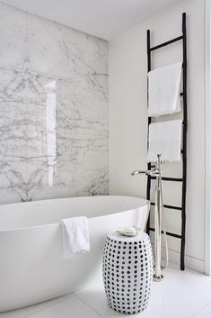 Everything about this minimalist bathroom exudes luxury, from the marble wall to the monochromatic colour palette, to a deep free-standing bath. Accessories only made it into the bathroom if they served a practical purpose – this helps to achieve a clean, Bathroom Stool, Marble Wall, Marble Bathroom, Bathroom Interior Design, Marble Bathroom Designs, Minimalist Bathroom, Small Bathroom Vanities, Free Standing Bath, Bathrooms Remodel