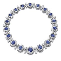 Important Sapphire and Diamond Necklace, Bulgari. Designed as a graduated series of clusters each set with an oval sapphire and brilliant-cut diamonds, alternating with marquise- and pear-shaped and brilliant-cut diamond spacers, mounted in platinum.