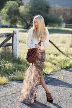 chunky cream cable-knit sweater, flowy slit skirt, and platforms