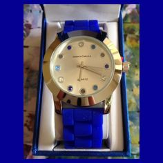 """Chrystal Watch. Beautiful Quartz Chrystal Watch.  Available in White with gold tone face and Blue with silver tone face.  Face diameter 38mm with 3/4"""" width band. Buckle closure. Jessica Carlyle Accessories Watches"""