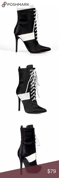 Fahrenheit Black Pointed Toe High Heel Bootie Fahrenheit Black Pointed Toe Women's Sneaker High Heel Bootie   It's sneaker bootie time with these pointed toe mid calf booties that will have you looking and feeling comfortable all day long. Donna features a pointed toe, inner zipper closure, sneaker upper, lace up closure and constrasting stripes.  Product Features  faux satin, rubber outsole, 4.25 inch heel Fahrenheit Shoes Ankle Boots & Booties