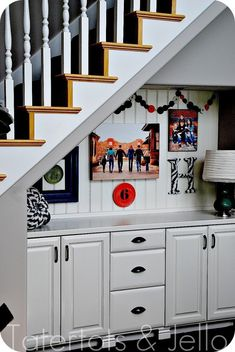 family picture wall & awesome desk & nook underneath stairs. via @jen (would be pretty cool for a fin. bsmt)
