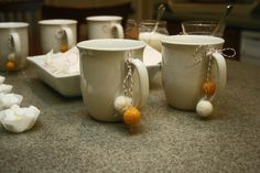 cute felted ball tutorial for little accents like these on the mugs! such a cute way to dress up a party or holiday!