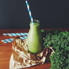 a green superfood smoothie with kale, passionfruit, mango, banana, oats, coconut water, flaxseeds…