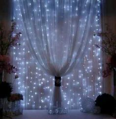 Hang miniature lights behind curtains