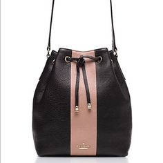 """Kate Spade bucket bag with dust bag Black with pink strip, pebbled leather and drawstring closure. Dust bag included. 10"""" drop length. kate spade Bags Shoulder Bags"""