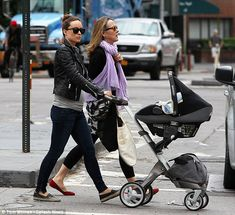 Olivia Wilde pushes baby Otis in a Stokke Xplory stroller pram with Maxi Cosi car seat in NYC