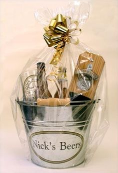 groomsmen gifts, Kelsey ? Maybe something like this with a picture frame, beverages, a cigar, some snacks? I have 2 buckets you want them