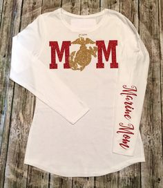United States Marine Corps Mom Shirt, Marine Corps GlitterShirt, Love, U.S. Marines Clothing, Military Shirts, USMC Shirts **** IF YOU WANT DIFFERENT COLOR GLITTERS THAN WHAT IS PICTURED EMAIL US OR LEAVE THE TWO COLORS IN THE MESSAGE TO SELLER AT CHECKOUT. Be sure to wash inside out. That is to protect the glitter from being damaged. We use high quality materials to make sure that you get a lasting Shirt! Returns: Are accepted with in five business days of delivery to purchaser. Buyer is...