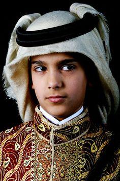 Qatari boy in traditional clothing