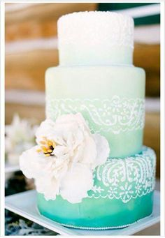 Genesis Master Of Events Beautiful ombré cake with lace design and flower.