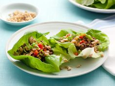Ellie's Lettuce Cups With Tofu and Beef : Ellie Krieger infuses lean ground beef with Asian flavors plus water chestnuts and peanuts, creating a texture-rich accompaniment to crunchy lettuce.