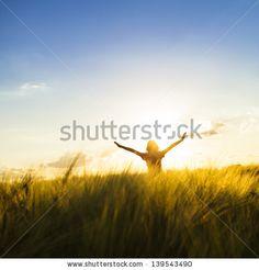 Teenage girl enjoy with sunshine in wheat field by oksix, via Shutterstock