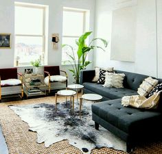 I like the idea of a cow hide rug for my living room. It looks great layered up like this