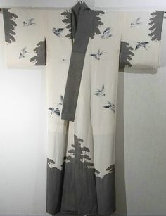 Japan, Edo-Komon Houmongi Kimono with a scenery of the swallow playing with lope curtain, which is dyed. Silhouette of scenery like forest is designed on the sleeves and around the hem