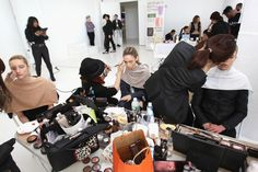 NEW YORK, NY - FEBRUARY 14: Models prepare backstage during SheaMoisture at Laquan Smith F/W 2016 NYFW at Jack Studios on February 14, 2016 in New York City. (Photo by Bennett Raglin/Getty Images for SheaMoisture)