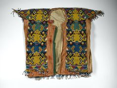 Coat of variegated beadwork in web backed with cotton cloth, showing an anthropomorphic design in bands: Indonesian, Borneo, Sarawak, Sea Dyak  Museum reference A.1906.112  Production information Sarawak, Borneo, Indonesia, SOUTH EAST ASIA  Style / Culture Sea Dyak