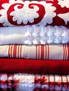 These textiles are gorgeous! I love the red prints: I would love to do a suite in these colors!