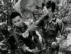 A South Vietnamese soldier, punches the face of a suspected Viet Cong guerrilla  March, 1965.