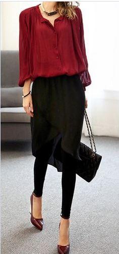Red top, black skirt, black leggings.