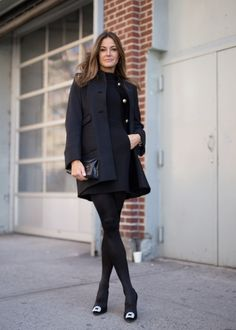 Kelly Bensimon black button up coat, black dress with pockets #NYFW