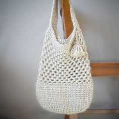 This beautiful crocheted market bag has a sturdy bottom and airy top, making it the perfect carry all! Grab the free pattern!