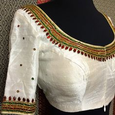 Raw silk with temple jewelry design hand embroidery. Custom order and colors available. Stone Work Blouse, Hand Work Blouse Design, Simple Blouse Designs, Blouse Designs Silk, Bridal Blouse Designs, Blouse Patterns, Kalamkari Dresses, Kurti Sleeves Design, Maggam Work Designs