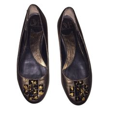 DVF Sz 8M Gold Black Jeweled Flats EUC DVF Sz 8M Gold Black Jeweled Used Flats Good condition except the backs do have wear. Not horrible condition but does have signs of wear. Please see picture 3 and please ask additional questions. Still lots of life left in them, great flats and super comfortable! Diane von Furstenberg Shoes Flats & Loafers