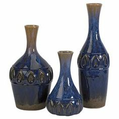 "Set of 3 glazed ceramic vases in blue and tan with geometric accents.   Product: Small, medium, and large vaseConstruction Material: CeramicColor: Blue and tanDimensions: 18"" H x 4.5"" Diameter (large)"