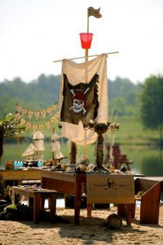 Throw your own Blackbeard Pirate Party, complete with a replica ship and crew activities. Check out the rest of Pan the Movie's Pirate Party board for more ideas. Deco Pirate, Pirate Theme, Pirate Kids, Pirate Birthday, Boy Birthday, Decoration Pirate, Pirate Centerpiece, Party Deco, Party Party