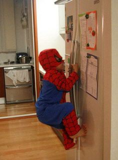 This will be AJ in a few months. He already tries to do chin ups off of the oven bar