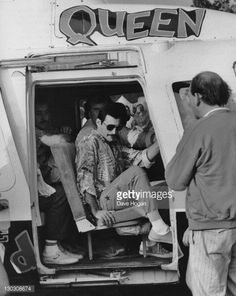 Singer Freddie Mercury (1946 - 1991) of British rock band Queen arrives at the Knebworth Festival by helicopter, 9th August 1986.