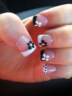 Black and White French Tips with Contrasting Flowers! | See more at http://www.nailsss.com/acrylic-nails-ideas/2/