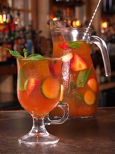 Triple Bow Punch - Pimm's, Triple Sec, Lime, Hard Cider, Cucumber Slices, Strawberries, Mint