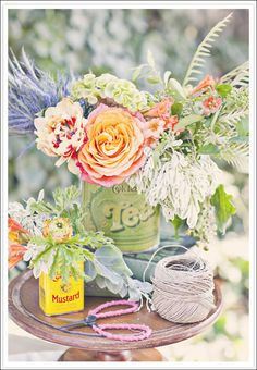 Love the idea of using old tins as place holders or centerpieces!