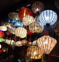 Chinese lanterns + twinkle lights...could look nice!