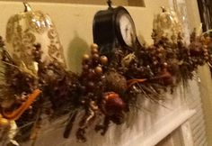 10/2012. Created Fall/Harvest located on the fireplace mantel in our new home.