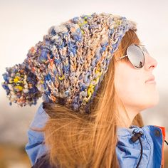 Aspen Ice Hat - Free knit hat pattern for handspun bulky yarn. The easy lace stitch makes a spiral that shows off brightly-colored yarn like this Magnolia Handspun.
