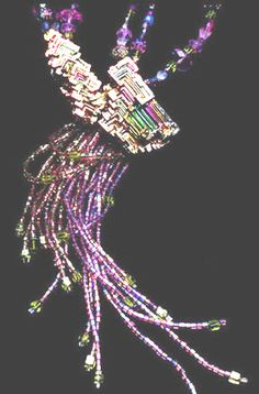 Bismuth crystal necklace by Virgo Moon (Mary Hicklin). Bismuth crystal, Old German iridescent beads, amethyst, peridot, vintage seed beads