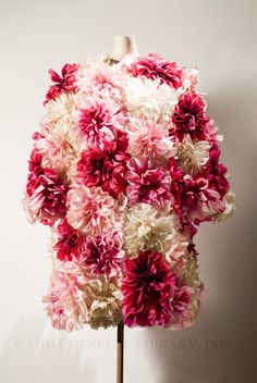 This flower-covered Norman Norell evening coat, though not featured, would have been a perfect fit for the Vogue editorial. Hand-dyed silk flowers in shades of pink and white are stitched to the coat, which is lined in pink silk. A center-front opening is hidden by the oversize flowers. #FDIM