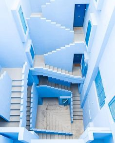 La Muralla Roja in Calpe, Spain, called a 'Labyrinth' by architect Ricardo Bofill. Photo Bleu, Light Blue Aesthetic, Aesthetic Pastel, Everything Is Blue, Love Blue, Blue Green, Blue Walls, Belle Photo, Stairways
