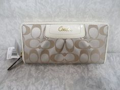 'Authentic Coach Khaki Ivory Patent  Zip Around Wallet' is going up for auction at  9pm Wed, Jan 2 with a starting bid of $80.