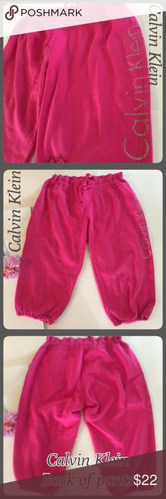 """Calvin Klein Lightweight Hot Pink Crop Sweatpants EUC Calvin Klein Performance Quick Dry lightweight Crop sweatpants. Has Calvin Klein written down the leg in silver. Size Large. (Fits 14 best imo) Measurements of waist laying flat with waist pulled out (not pulled in with drawstring at all is 18"""", drawstring pulled I would say fits 15-16"""" waist laying flat. Elastic band bottom opening measures 6"""". Hips 22"""" across, thigh 12"""" across. 80% Cotton 20% Polyester. Inseam 19"""". Tech pocket on back…"""