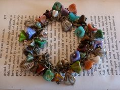 Multi-color Czech flower beaded bracelet, glass leaves, picasso beads. $35.00, via Etsy.