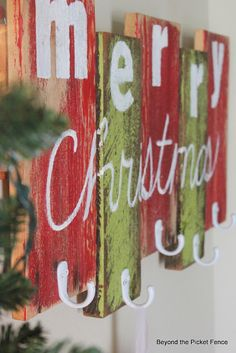 No Fireplace?  No problem!! Make a Reclaimed Wood Stocking Hanger bec4-beyondthepic...