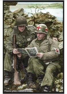 An American Medic and a GI of the US. Infantry Division reading a comic at Reisdorf in Luxembourg near the German Border. of February 1945 Left to right : Pfc Reynold H. Bush Middletown, Ohio , and Pfc Aurelio Maltese, New York, pin by Paolo Marzioli
