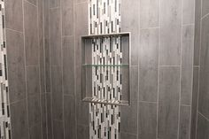 Shower Niche with Glass Shelf and Waterfall Tile Glass Tile Shower, Rain Shower Bathroom, Mosaic Shower Tile, Subway Tile Showers, Bathroom Towel Decor, Shower Tile Designs, Marble Showers, Shower Niche, Bathroom Styling
