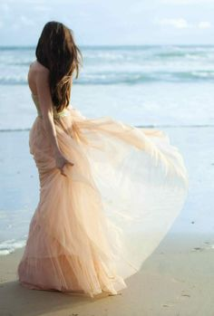 Gorgeous pale pink gown, loose hair, on the beach...lovely, easy, breezy!